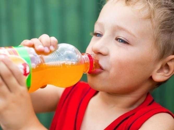 Boy Drinking Orange Soda for ChildLife Nutritional Supplements for Kids Blog Post on Avoiding Artificial Flavorings