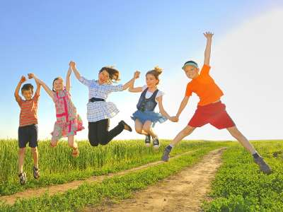 Five Kids Holding Hands and Jumping in the Air for ChildLife Nutritional Supplements for Kids Blog Post on Immune Support Super Stars