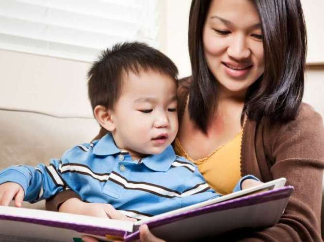 Mother Reading to Son for ChildLife Nutritional Supplements for Kids Blog Post on Cod Liver Oil