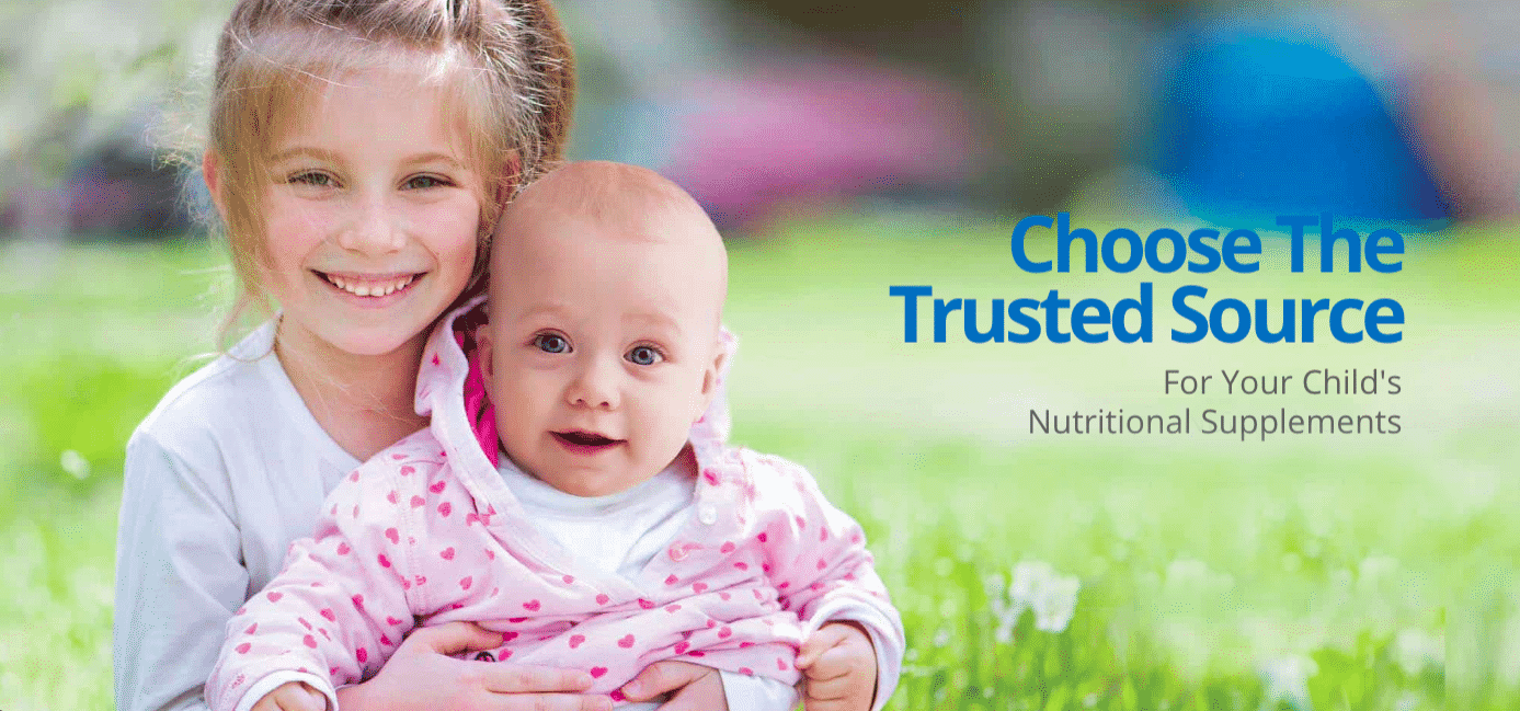 Little Girl Holding Baby Sister Sitting in the Grass That States Choose The Trusted Source for Your Child's Nutritional Supplements as Image for ChildLife Nutritional Supplements for Babies, Toddlers and Kids