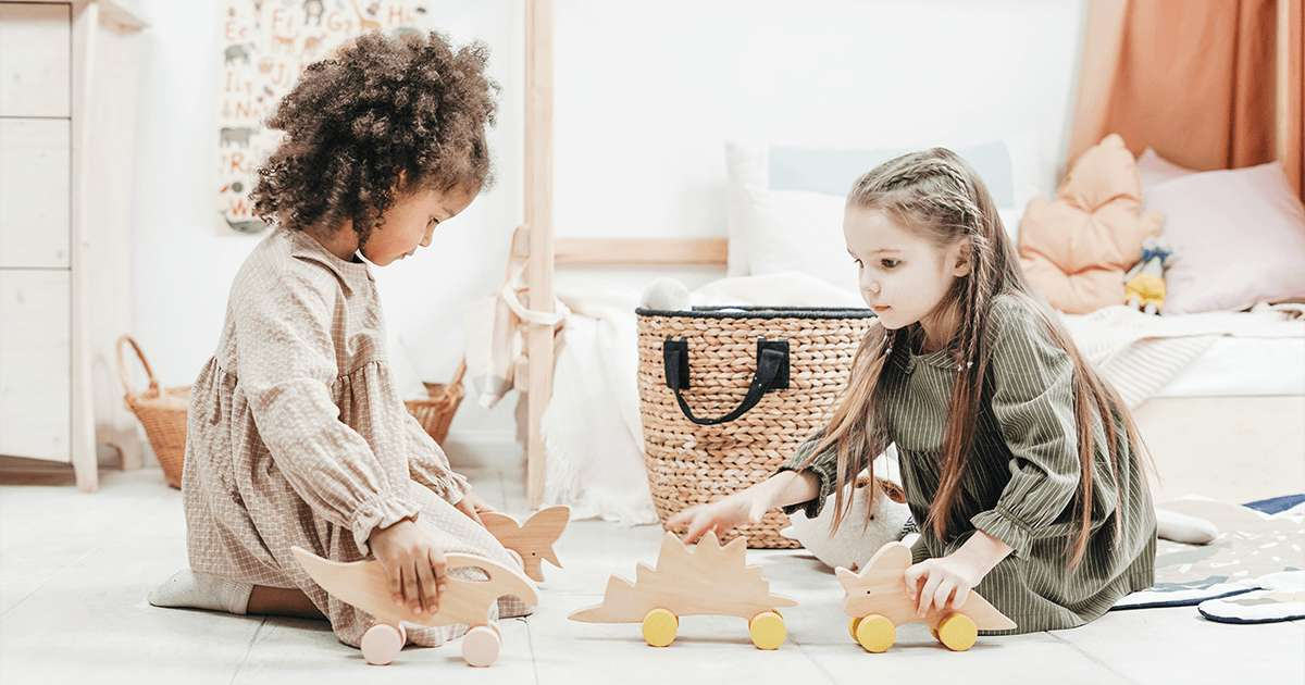 ChildLife Essentials: photo-of-girls-playing with wooden toys